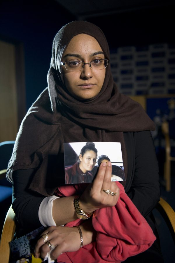 Shamima's sister holds her photo