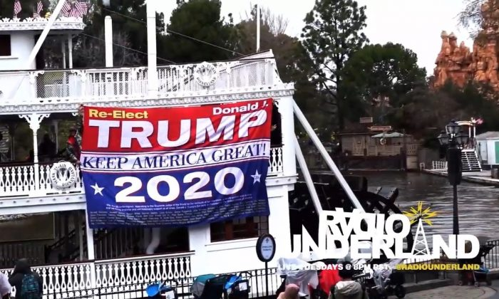 "A banner reading ""Re-elect Trump"" and ""Keep America Great!"" was unfurled at Disneyland in Anaheim, Calif., on Feb. 13, 2019, leading to the banning of a guest. (Image from Radio Underland YouTube video of incident)"
