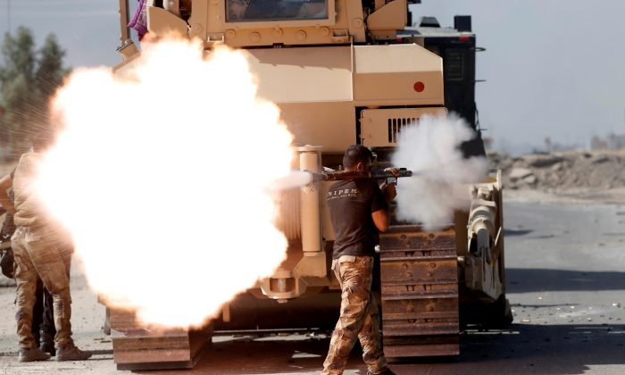An Iraqi special forces soldier fires an RPG during clashes with ISIS terrorists in Bartella, east of Mosul, Iraq, on Oct. 20, 2016. (Goran Tomasevic/File Photo/Reuters)