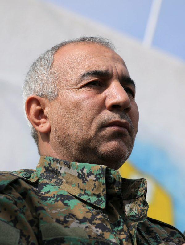 Jiya Furat talks during a press conference near Baghouz
