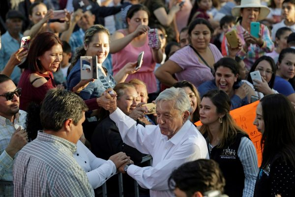 Mexico's President Andres Manuel Lopez Obrador greets people during his arrival to an event in Badiraguato