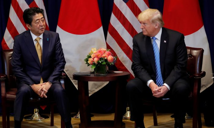 President Donald Trump listens to Japan's Prime Minister Shinzo Abe during a bilateral meeting on the sidelines of the 73rd session of the United Nations General Assembly in New York, Sept. 26, 2018. (REUTERS/Carlos Barria.)