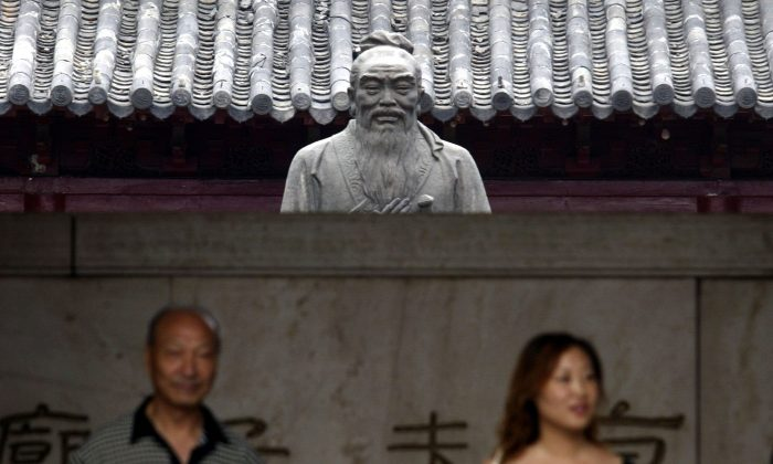 Tourists in front of a statue of Confucius in Nanjing, Jiangsu Province, China, in this file photo. (China Photos/Getty Images)