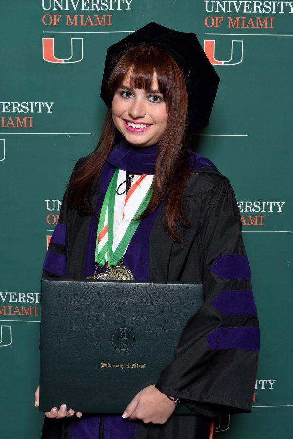 Moss graduating law school