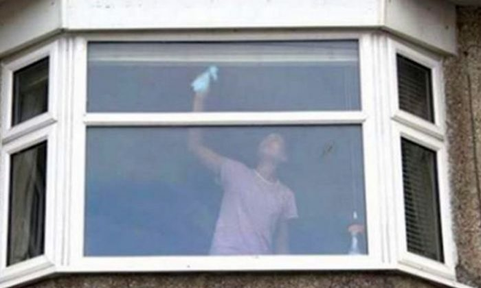 UK Cops Post Photo of Woman Cleaning Windows as a Warning