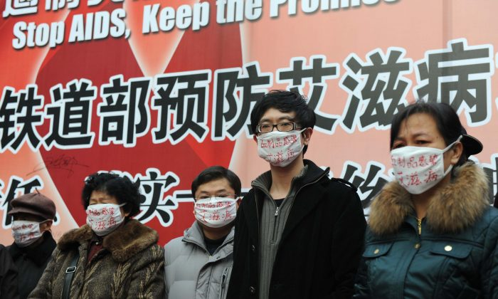 Hemophiliac protesters, all of whom contracted HIV from infected blood products, wear surgical masks as they demonstrate during an AIDS-awareness event on World AIDS Day at Beijing's south railway station on Dec. 1, 2009, to call for better government support for HIV/AIDS victims in China. (AFP/Getty Images)