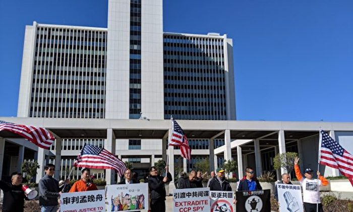 Chinese pro-democracy groups gather outside the FBI building in Los Angeles to call on the U.S. government to bring communist spies to justice. (Xu Xiuhui /The Epoch Times)