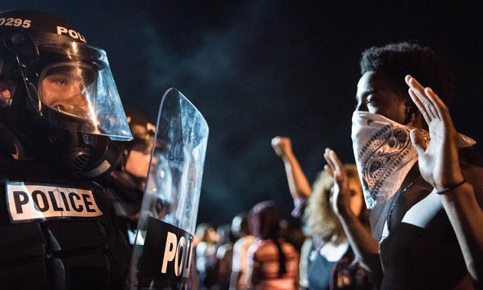 Police officers face off with protesters in in Charlotte, N.C., on Sept. 21, 2016.   Sean Rayford/Getty Images