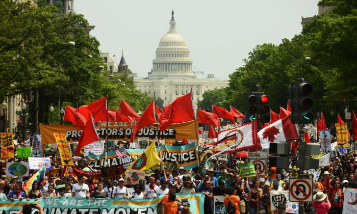 Environmentalists hold a protest march from the U.S. Capitol in Washington on April 29, 2017.  Astrid Riecken/Getty Images