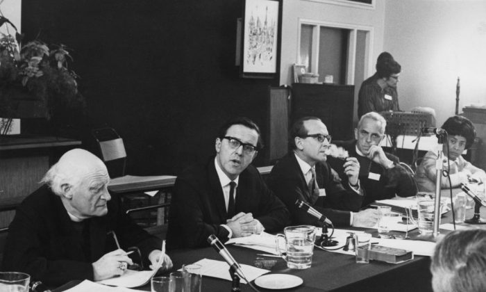 A panel discussion at the World Council of Churches Consultation on Racism at Notting Hill Ecumenical Centre in London on May 21, 1969. (L–R) Michael Ramsey, the archbishop of Canterbury, Merlyn Rees, Mark Bonham Carter, and Father Trevor Huddleston. (Ron Case/Keystone/Hulton Archive/Getty Images)