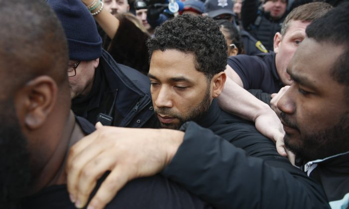 """""""Empire"""" actor Jussie Smollett leaves Cook County jail following his release in Chicago on Feb. 21, 2019. (Kamil Krzaczynski/AP Photo)"""