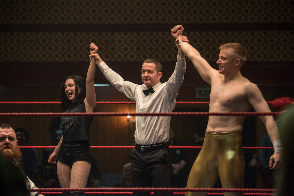two wrestlers and referee in ring