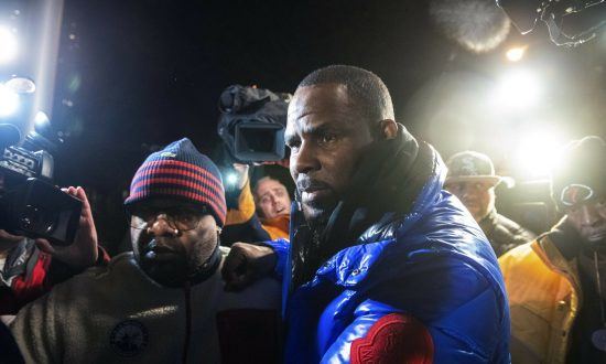 R. Kelly Arrested, Charged in Chicago With Sexual Abuse