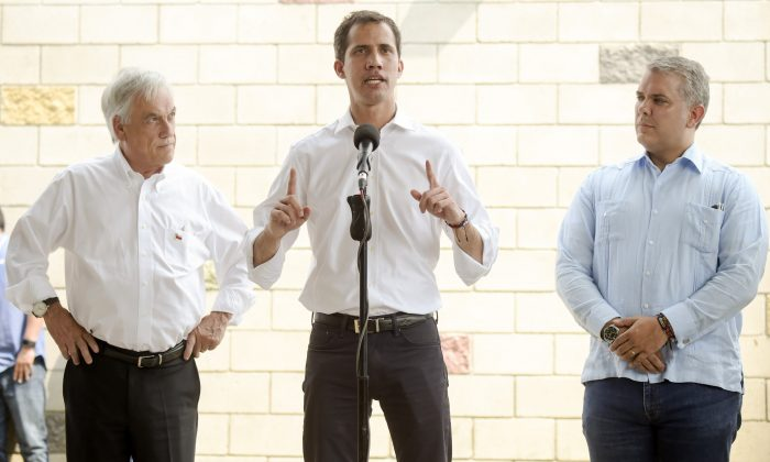 Venezuelan interim president Juan Guaido (C) speaks during a press conference, flanked by presidents Ivan Duque (R) of Colombia and Sebastian Pinera of Chile (L) in Cucuta on the Colombian side of the Tienditas International Bridge before the attempt to cross humanitarian aid over the border into Venezuela on Feb. 23, 2019. (Raul Arboleda/AFP/Getty Images)