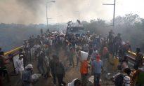 2 Killed as Maduro Sends Troops to Block Venezuela Aid Convoys