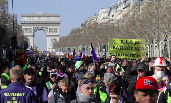 Protesters wearing yellow vests march down the Champs Elysees in Paris on Feb. 23, 2019. (Philippe Wojazer/Reuters)