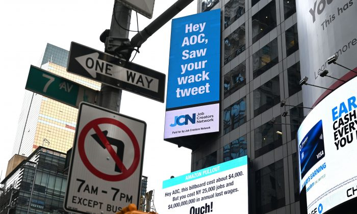 Signs placed by the Job Creators Network are seen on Times Square in New York on Feb. 23, 2019. (Timothy A. Clary/AFP)
