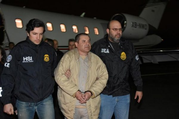 """Mexico's top drug lord Joaquin """"El Chapo"""" Guzman is escorted as he arrives at Long Island MacArthur airport in New York"""