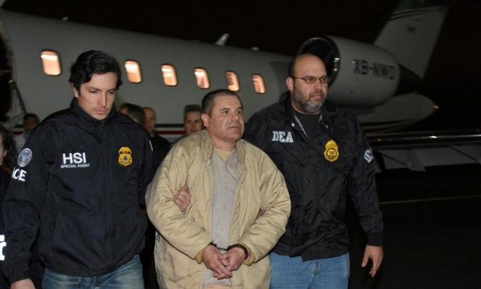 """Mexico's top drug lord Joaquin """"El Chapo"""" Guzman is escorted as he arrives at Long Island MacArthur airport in New York on Jan. 19, 2017, after his extradition from Mexico. (U.S. officials/Handout/Reuter)"""