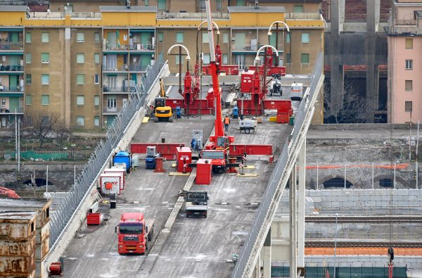 Construction workers dismantle the collapsed Morandi Bridge in Genoa, Italy