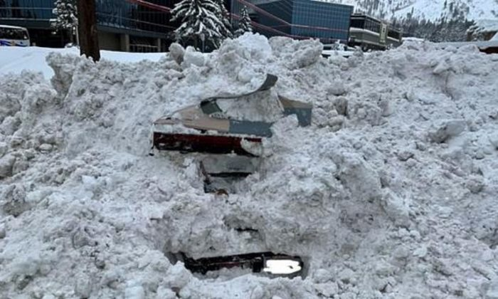 A snowplow struck a car that was completely buried by snow in South Lake Tahoe, California, on Feb. 17, 2019. Unbeknownst to crews, there was a woman inside. (City of South Lake Tahoe)