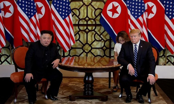 U.S. President Donald Trump (R) and North Korean leader Kim Jong-un (L) during their second summit meeting at the Sofitel Legend Metropole hotel in Hanoi, Vietnam, on Feb. 28, 2019. (Vietnam News Agency/Handout/Getty Images)