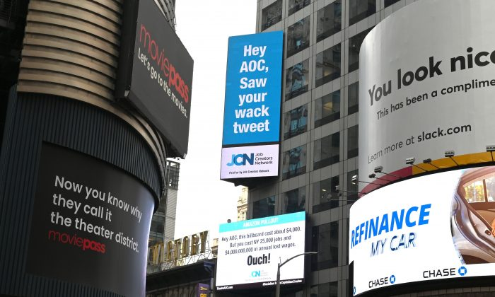Signs placed by the Job Creators Network are seen on Times Square on Feb. 23, 2019 in New York calling out Rep. Alexandria Ocasio-Cortez for the role they say she played in the recent termination of Amazons HQ2.(Timothy A. Clary/AFP/Getty Images)