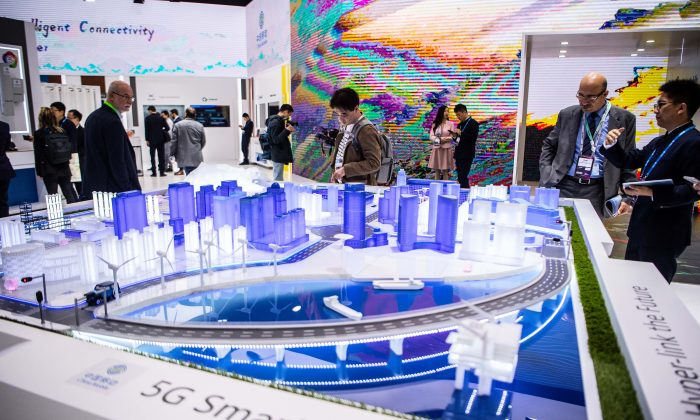 Visitors check a 5G Smart City technology at the China Mobile booth at the GSMA Mobile World Congress 2019 in Barcelona, Spain on Feb 26, 2019. The annual Mobile World Congress hosts some of the world's largest communications companies, with many unveiling their latest phones and wearables gadgets like foldable screens and the introduction of the 5G wireless networks. (David Ramos/Getty Images)