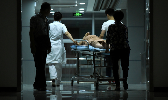 A pregnant woman on a stretcher in hospital in Beijing, China. (WANG ZHAO/AFP/Getty Images)