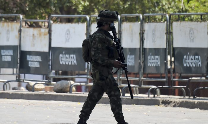 A Colombian soldier patrols the area around the the Simon Bolivar International Bridge in Cucuta, Colombia, on the border with Venezuela on Feb. 26, 2019. The Colombian government closed the area at least until midnight. (RAUL ARBOLEDA/AFP/Getty Images)