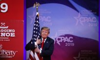 President Trump Embraces American Flag Before CPAC Speech