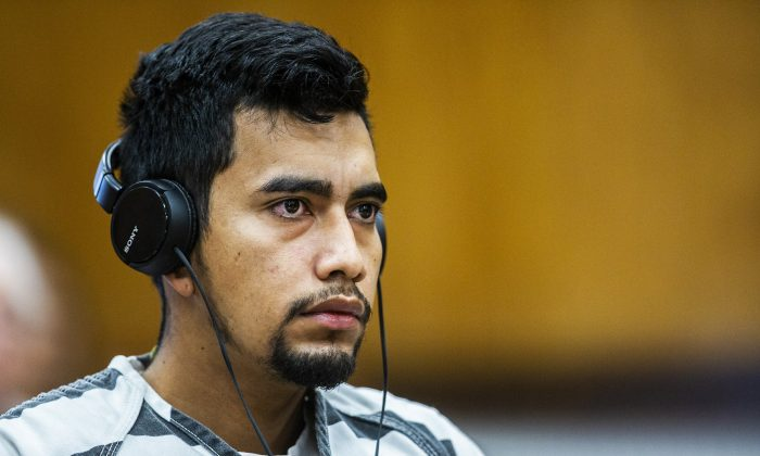 Cristhian Bahena Rivera wears headphones during his arraignment where he pleaded not guilty to the charge of first-degree murder in the death of Mollie Tibbetts at the Poweshiek County Courthouse in Montezuma, Iowa., on Sept. 19, 2018. (Kelsey Kremer/Des Moines Register via AP)