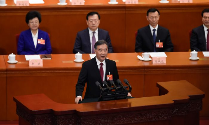 Wang Yang (C), chairman of the Chinese Communist Party's Political Consultative Conference, delivers his work report in the Great Hall of the People in Beijing on March 3, 2019. (WANG ZHAO/AFP/Getty Images)