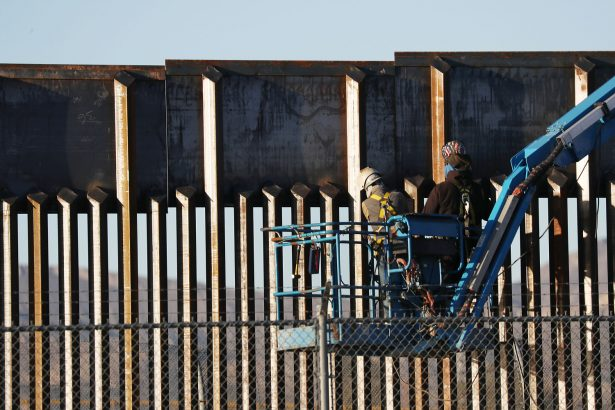 People work on the U.S.–Mexico border wall in El Paso, Texas, on Feb. 12, 2019. (Joe Raedle/Getty Images)