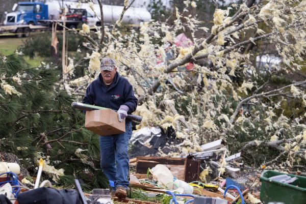 man salvages belongings
