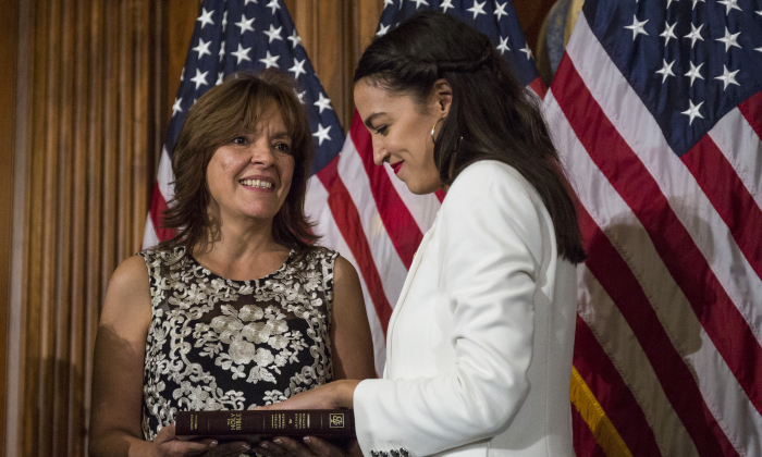 Rep. Alexandria Ocasio-Cortez (D-NY) takes part in a ceremonial mock swearing in ceremony with her mother, Blanca Ocasio-Cortez on Capitol Hill on January 3, 2019 in Washington, DC. (Zach Gibson/Getty Images)