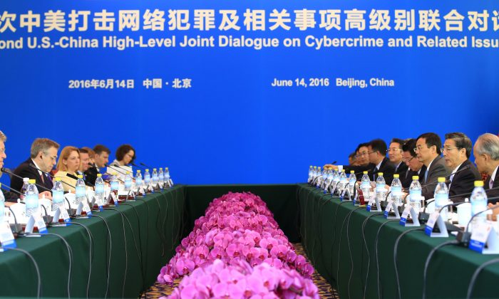 China's Minister of Public Security Guo Shengkun (3rd R) and U.S. Ambassador to China Max Baucus (2nd L) attend the second U.S.-China High-Level Joint Dialogue on Cybercrime and Related Issues at the Diaoyutai State Guesthouse in Beijing on June 14, 2016. (Jason Lee/AFP/Getty Images)
