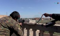 Hundreds of ISIS fighters surrender in east Syria