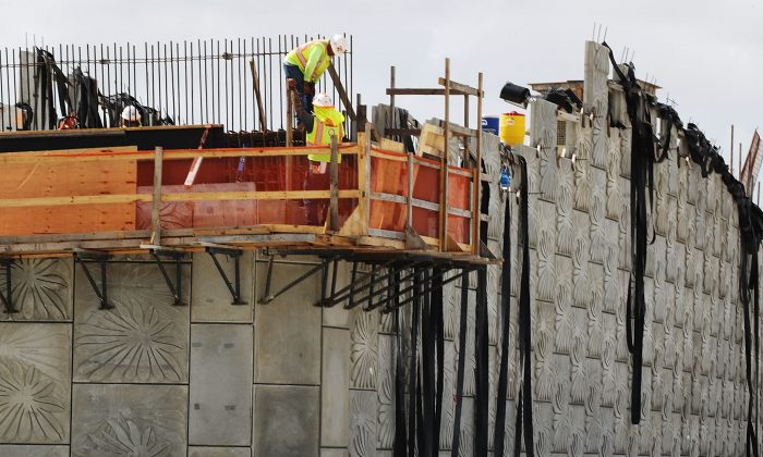 Construction workers build along State Road 836 in Miami, Florida, on Feb. 12, 2018. (Joe Raedle/Getty Images)