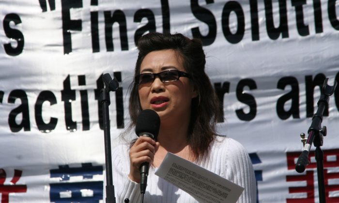 Annie (alias), ex-wife of a brain surgeon who removed organs from thousands of Falun Dafa prisoners of conscience in China in the early 2000s, speaks at a press conference in Washington, D.C., on April 20, 2006. (The Epoch Times)