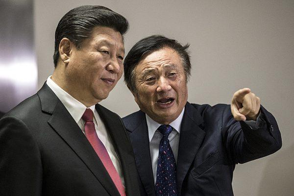 Huawei President Ren Zhengfei (R) shows Chinese leader Xi Jinping around