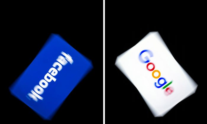 The logos of Google and Facebook displayed on a tablet in Paris, on Feb. 18, 2019. (Lionel Bonaventure/AFP/Getty Images)