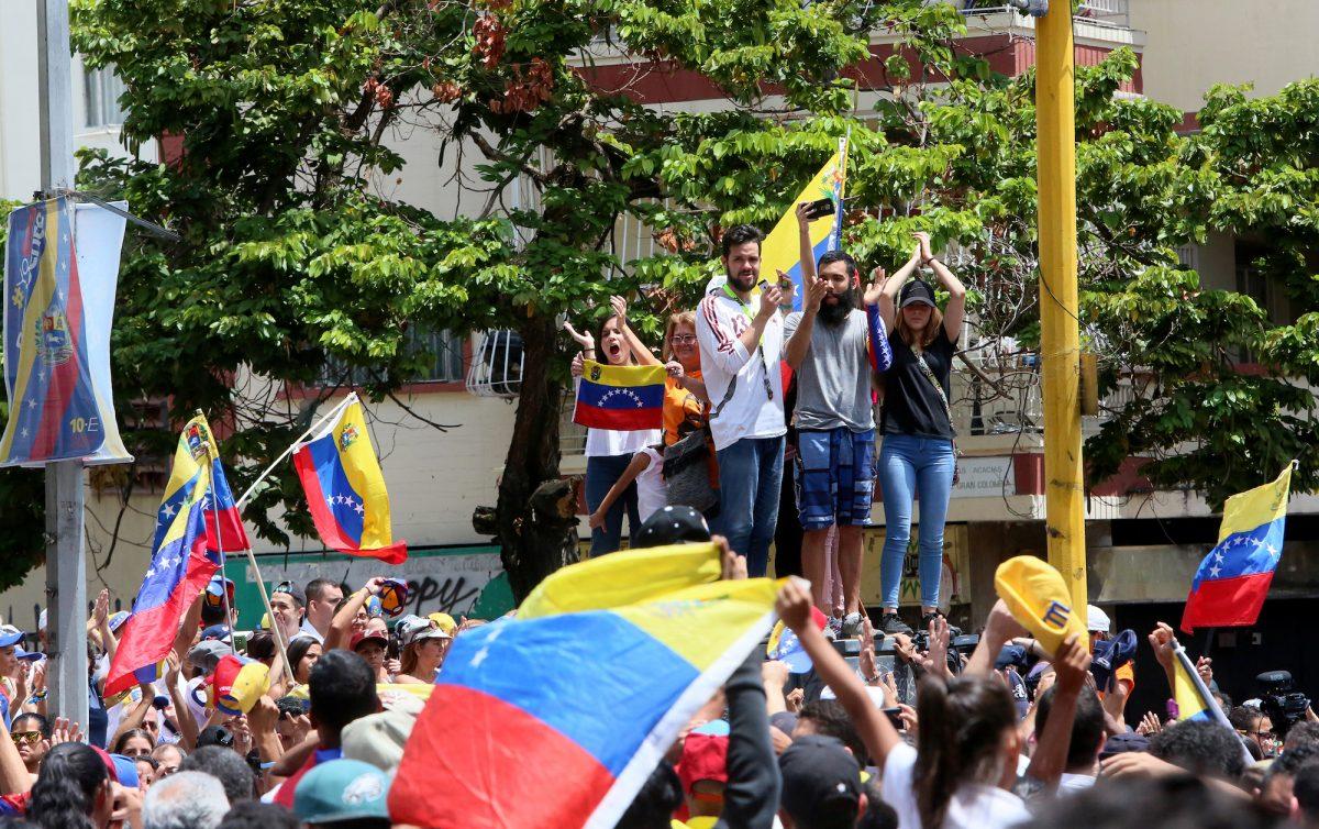 Venezuelans take part in a protest against the Maduro regime