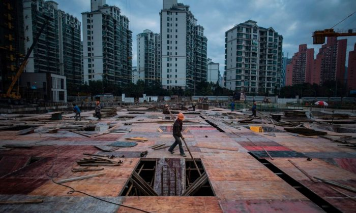 A man works at a construction site of a residential skyscraper in Shanghai. (JOHANNES EISELE/AFP/Getty Images)