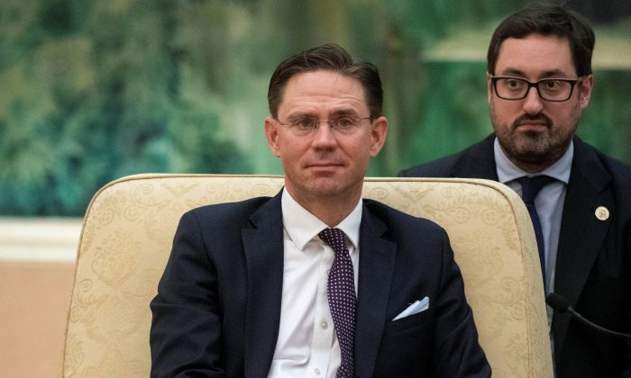 European Commission Vice President Jyrki Katainen listens to China's Premier Li Keqiang (not pictured) during a meeting at the Great Hall of the People in Beijing on June 25, 2018.  (Fred Dufour/Pool via Reuters)