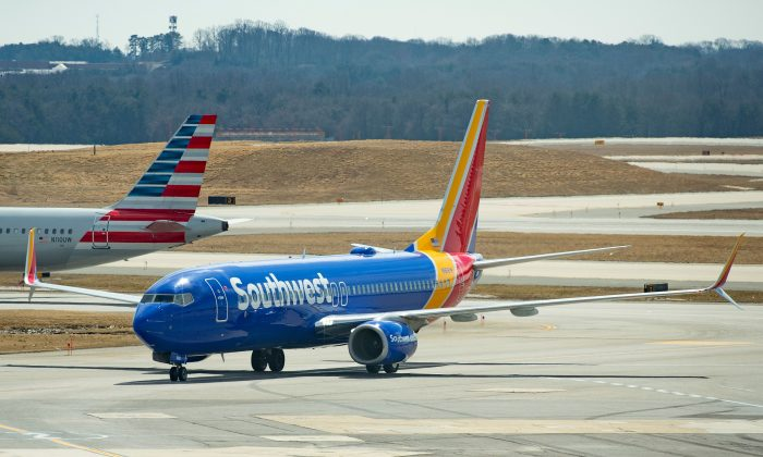 """A Boeing 737 Max 8 flown by Southwest Airlines taxis to the gate at Baltimore Washington International Airport near Baltimore, Maryland on March 13, 2019. - US President Donald Trump on March 13, 2019, announced a plan to ground all Boeing 737 MAX aircraft amid intense international and political pressure following the second deadly crash in less than five months. """"We're going to be issuing an emergency order of prohibition regarding all flights of the 737 MAX 8 and 737 MAX 9,"""" Trump told reporters the White House. (Photo by Jim WATSON / AFP)        (Photo credit should read JIM WATSON/AFP/Getty Images)"""