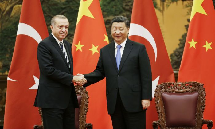 Turkish President Recep Tayyip Erdogan and Chinese leader Xi Jinping attend a signing ceremony in Beijing, China on May 13, 2017. China detained four Turkish businessmen on March 9, 2019. (Jason Lee- Pool/Getty Images)