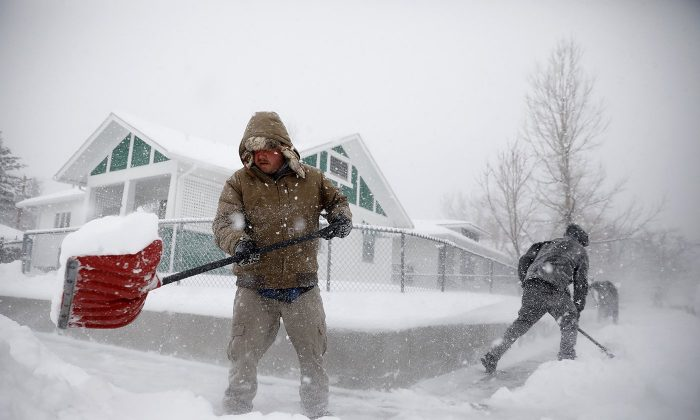 A stock photo of snow shoveling (Josh Galemore/The Casper Star-Tribune via AP)