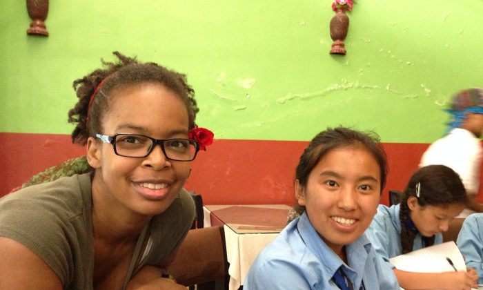 Katerina Canyon (L) volunteering with a student in Nepal. (Courtesy of Katerina Canyon)