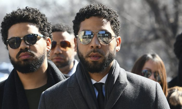 """Empire"" actor Jussie Smollett (C), at the Leighton Criminal Court Building for a hearing to discuss whether cameras will be allowed in the courtroom during his disorderly conduct case, in Chicago, on March 12, 2019. (Matt Marton/AP Photo)"